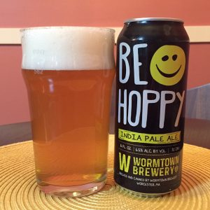 Wormtown Be Hoppy IPA poured into a nonic pint glass.