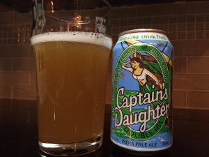 Captain's Daughter DIPA poured into a nonic pint glass with can next to it.