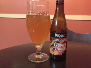 Dugges Tropical Sunrise Sour Ale in a tulip glass.