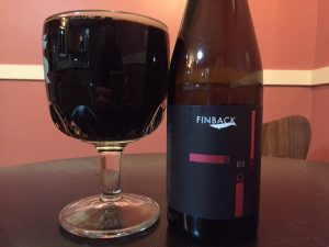 Finback BQE Imperial Chocolate Stout aged in bourbon barrels poured into a beer chalice.