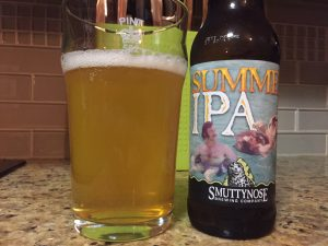 Smuttynose Summer IPA poured into a nonic pint glass.