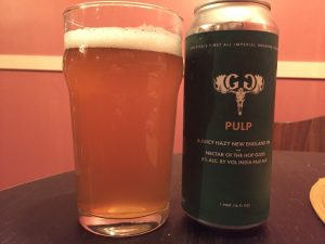 Greater Good Imperial Brewing Co. Pulp poured into a nonic pint glass.