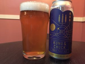 Theory Brewing Co. Kunu & Chuck IPA poured into a nonic pint glass.