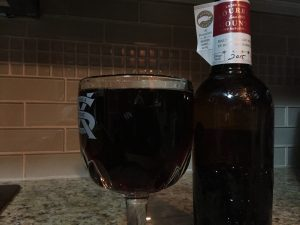 Goose Island 2015 Bourbon County Brand Barleywine Ale poured into a beer chalice.