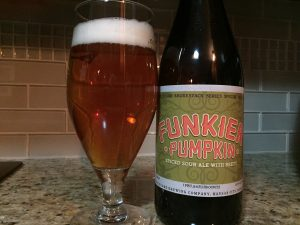 Beautiful copper colored beer with a white head - Boulevard Brewing Company Funkier Pumpkin poured into a tulip glass.